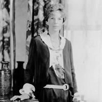 "Famous aviator Amelia Earhart (""Amelia Earhart, three-quarter length portrait, standing facing front"")"